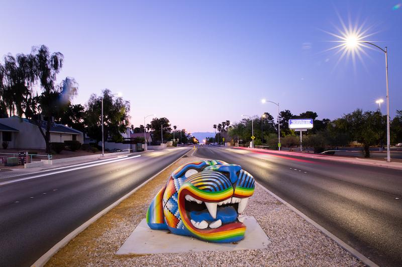 Gato Gigante is a large jaguar head in multi colors in the median of a street in Las Vegas