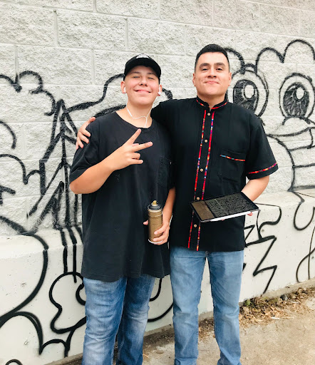 Alfredo Reyes with Tyson Tafoya, National Night Out, in Denver.