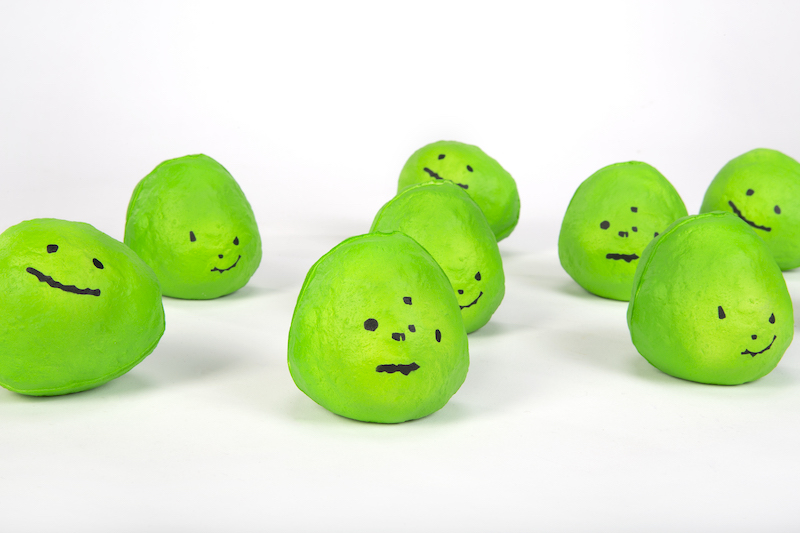 squishy looking limes with faces drawn on in sharpie