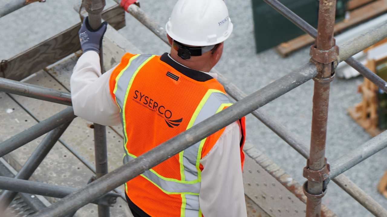 Top down image of a man in an orange vest and hardhat