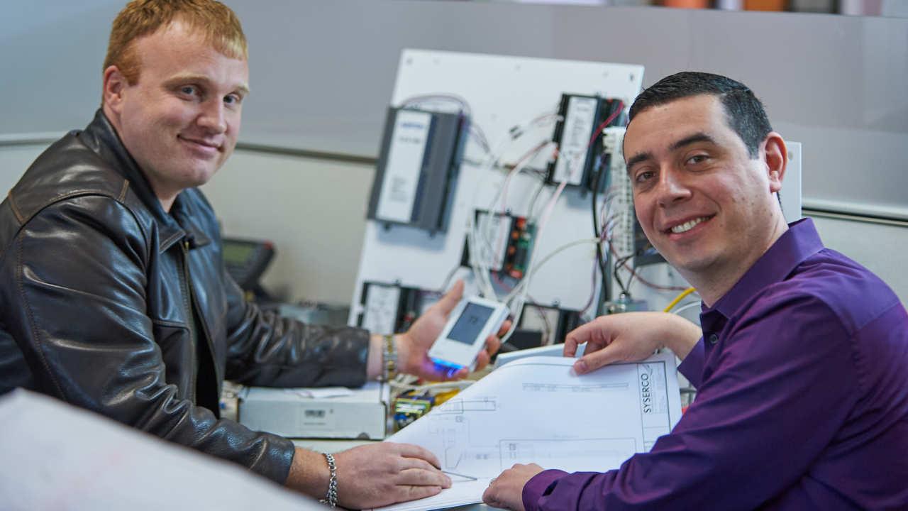 Two men enjoying work