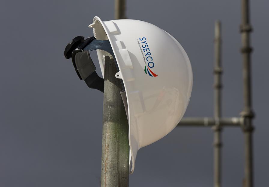white hardhat on a pole