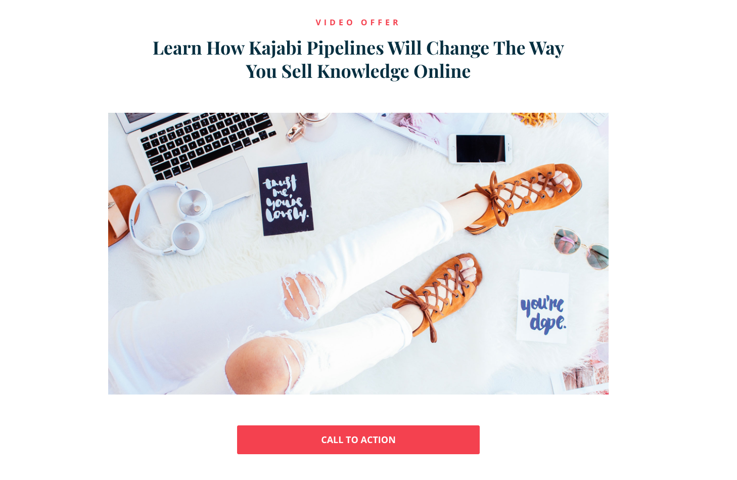 Kajabi landing page with an image of a person's legs and office equipment above a fuchsia call to action button