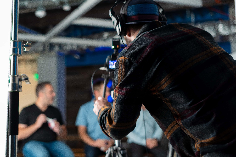 Film crew filming people talking