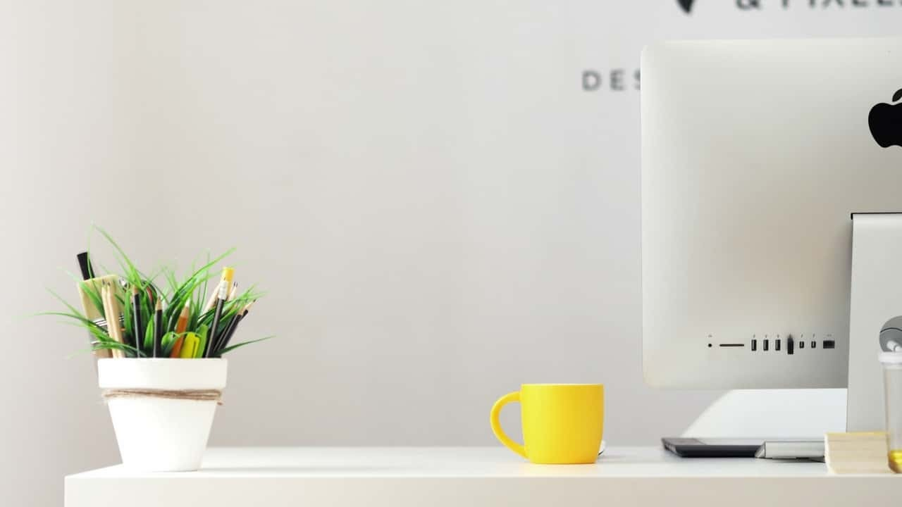 A yellow coffee cup on a desk