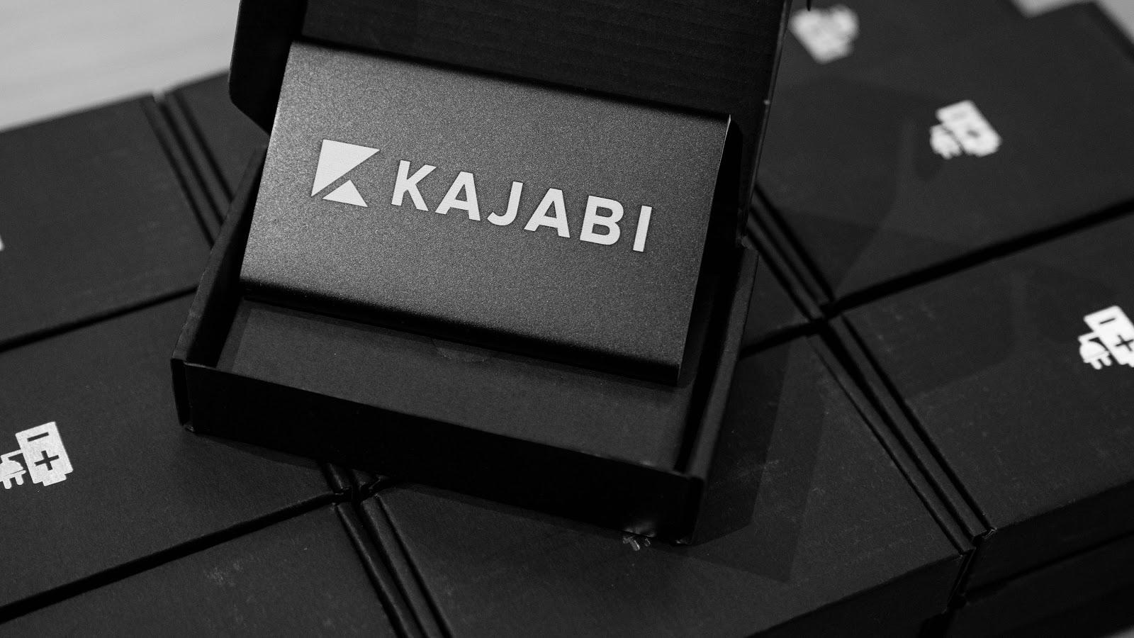 Kajabi logo on a business card
