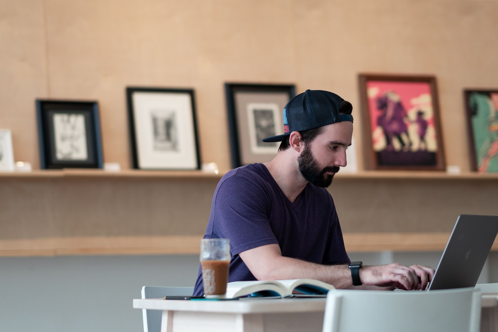Man working on a laptop in a coffee shop