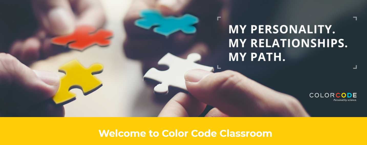 Website of Color Code Classroom with an image of hands holding four puzzle pieces