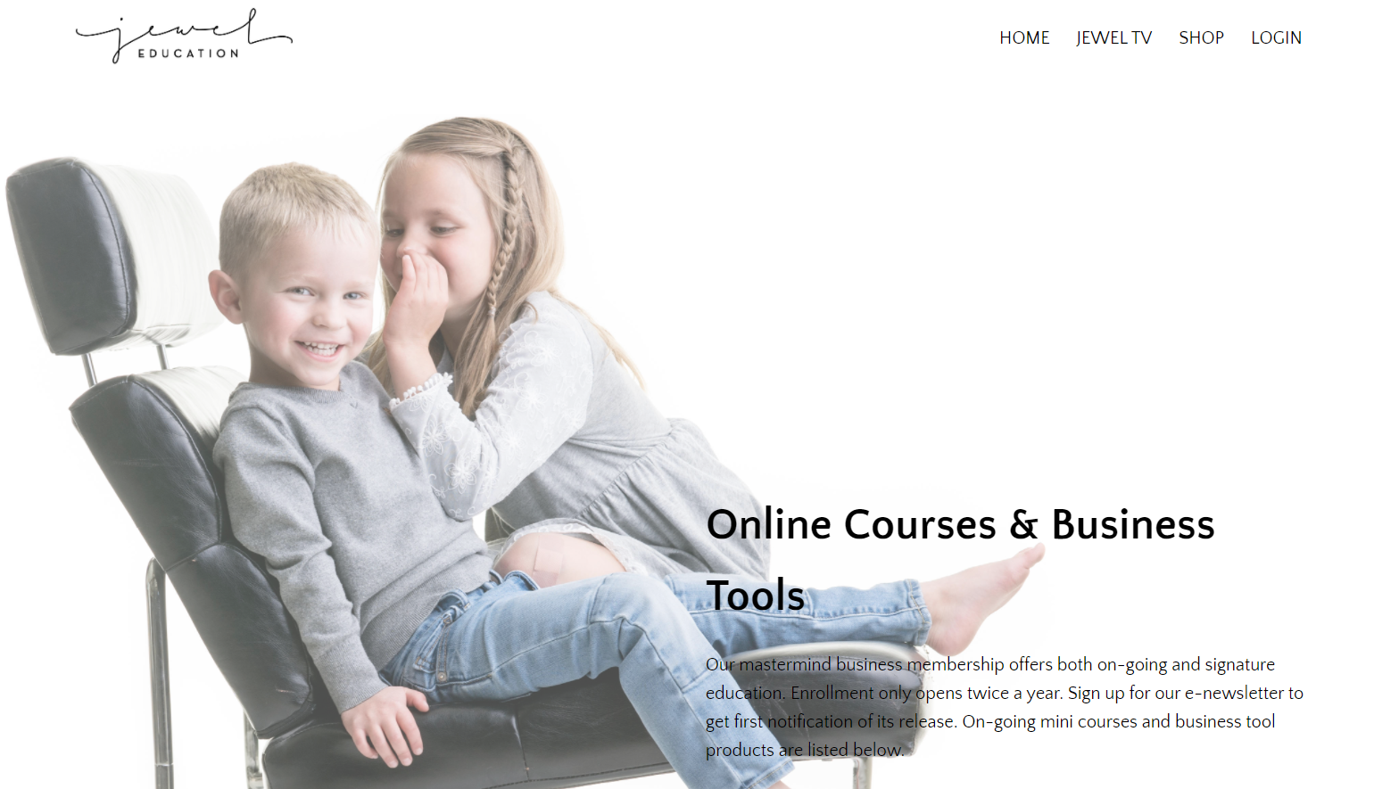 The Jewel Education website with an image of two young children in a black leather chair