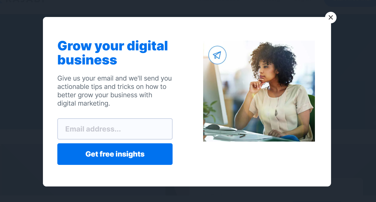 """Screenshot of the Kajabi exit intent popup saying """"Grow your digital business"""" and an image of a Black woman working on a computer"""