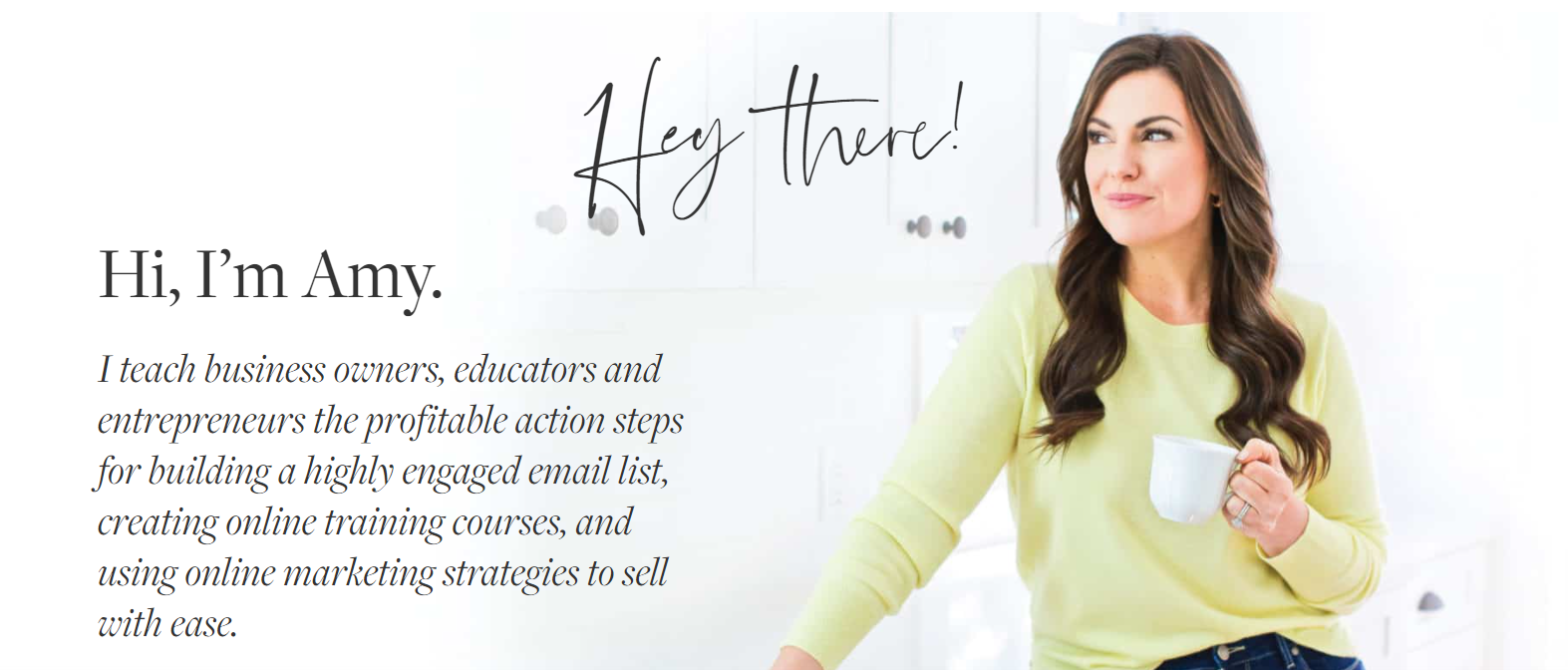 Screenshot of the Amy Porterfield website with a photo of her smiling holding a mug