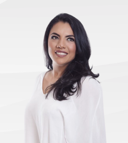 Photo of Jessi Penia smiling against a white background