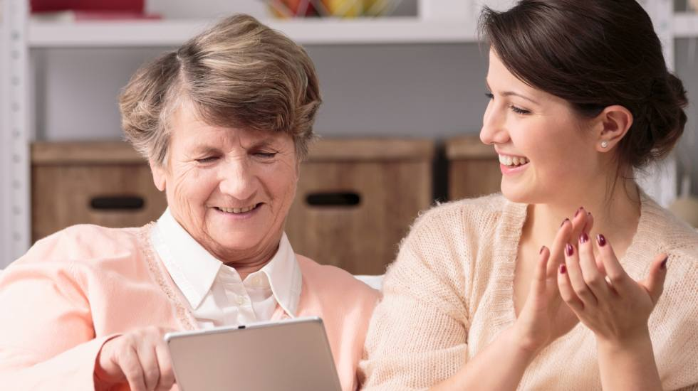 Two women using an iPad together