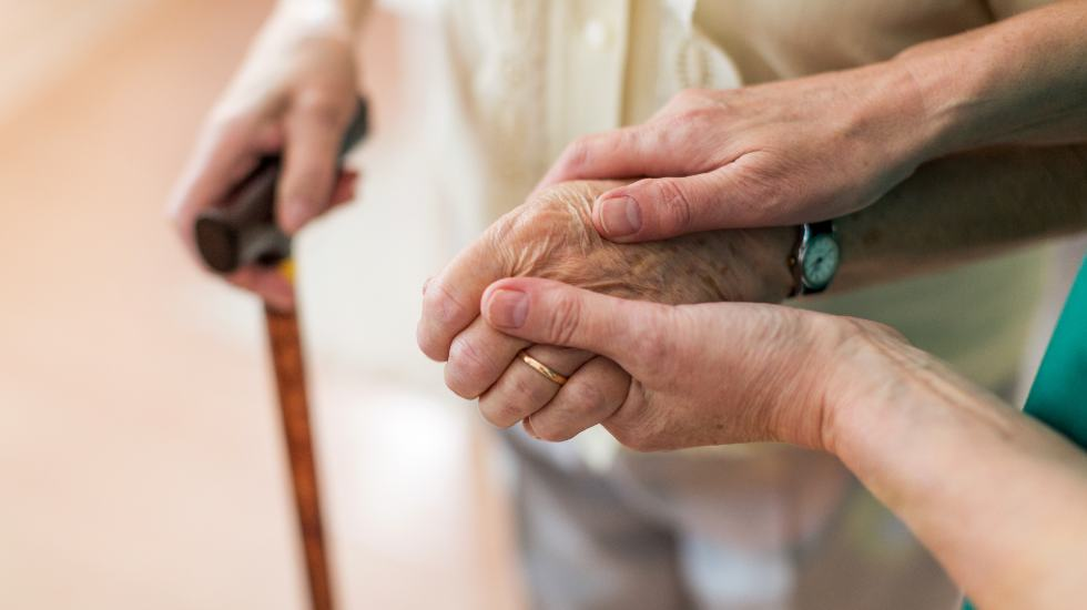 carer helping elderly patient