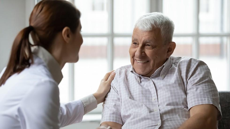 elderly man with nurse in emergency respite care