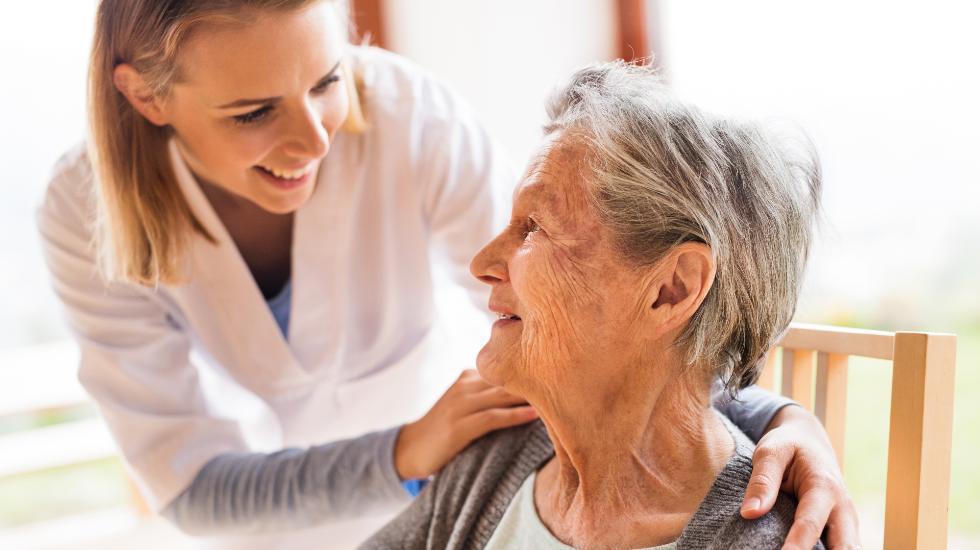 carer smiling at elderly patient