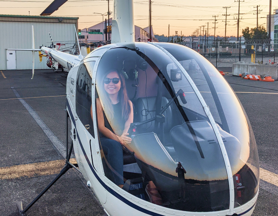 Woman in helicopter.