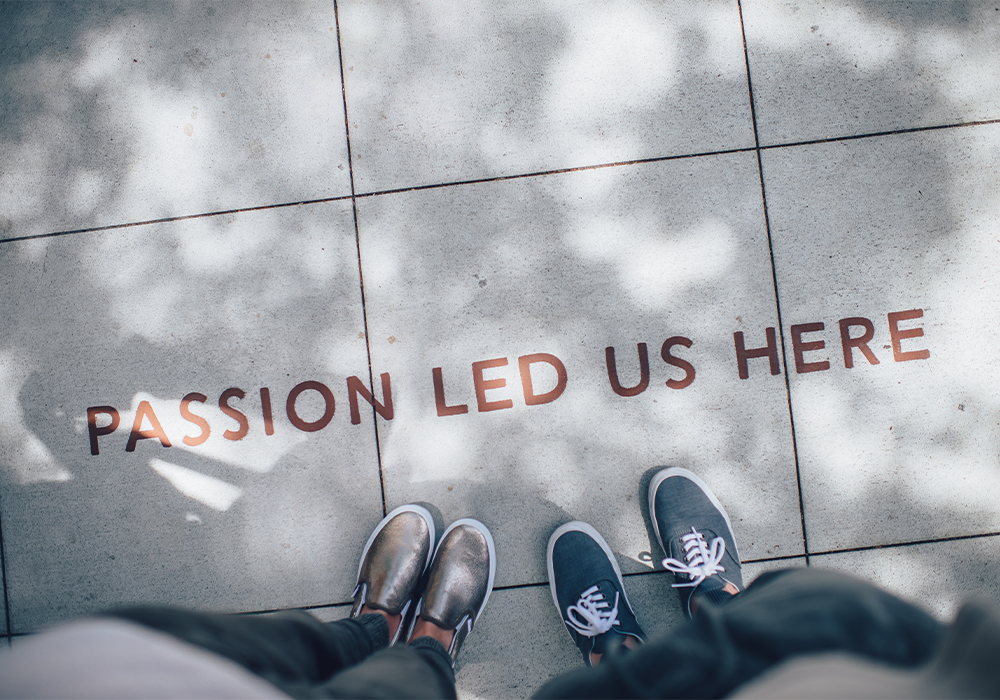 """PASSION LED US HERE"" written on the ground"