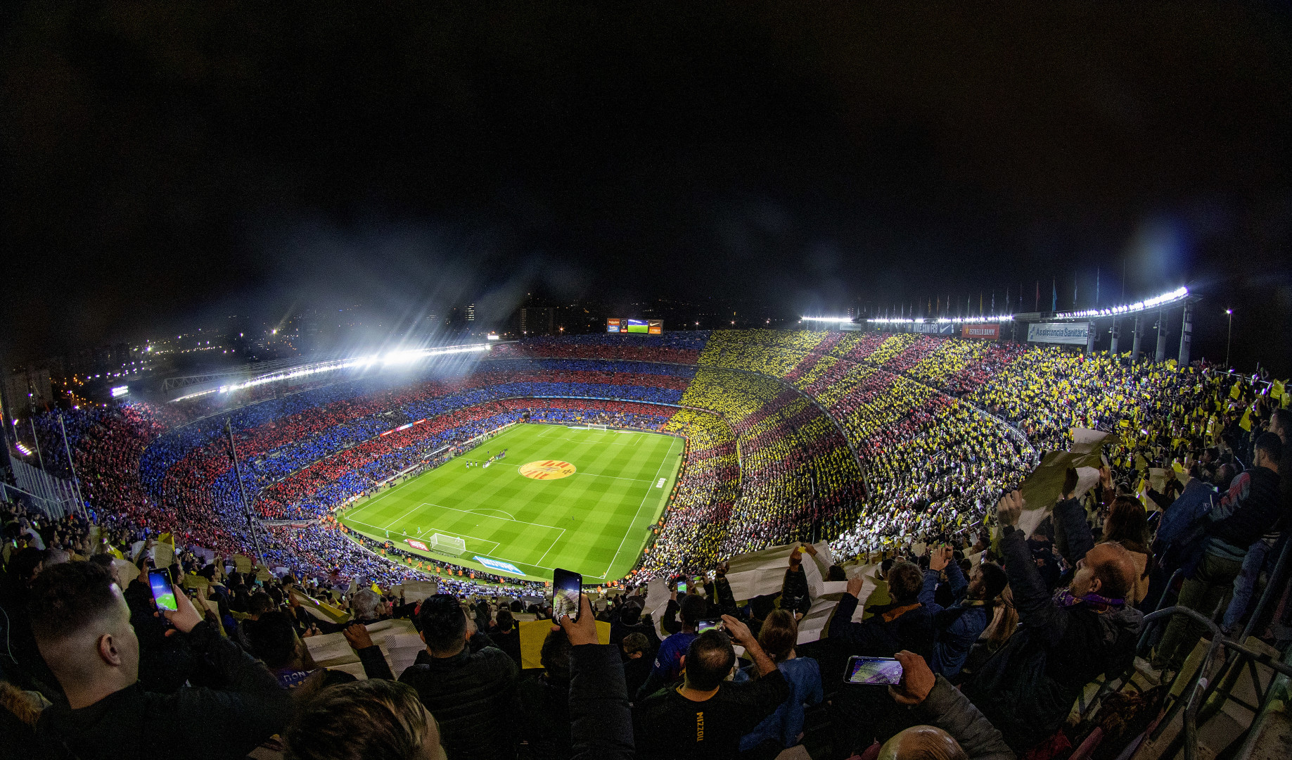 A spectacular panoramic view of Nou Camp Stadium as fans hold coloured placards before the start of the Barcelona V Real Madrid, La Liga regular season match at Estadio Camp Nou on December 18th 2019 (optimized)