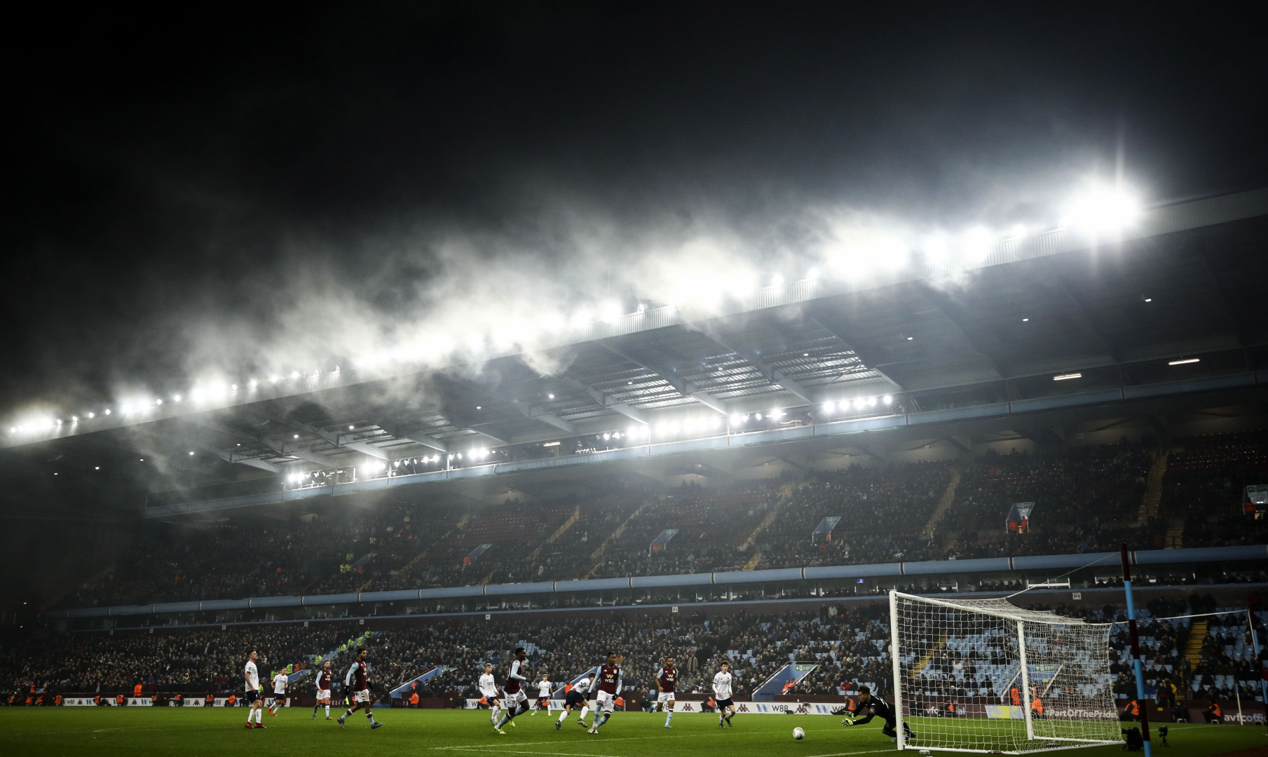 Football in the fog at Villa Park (optimized)