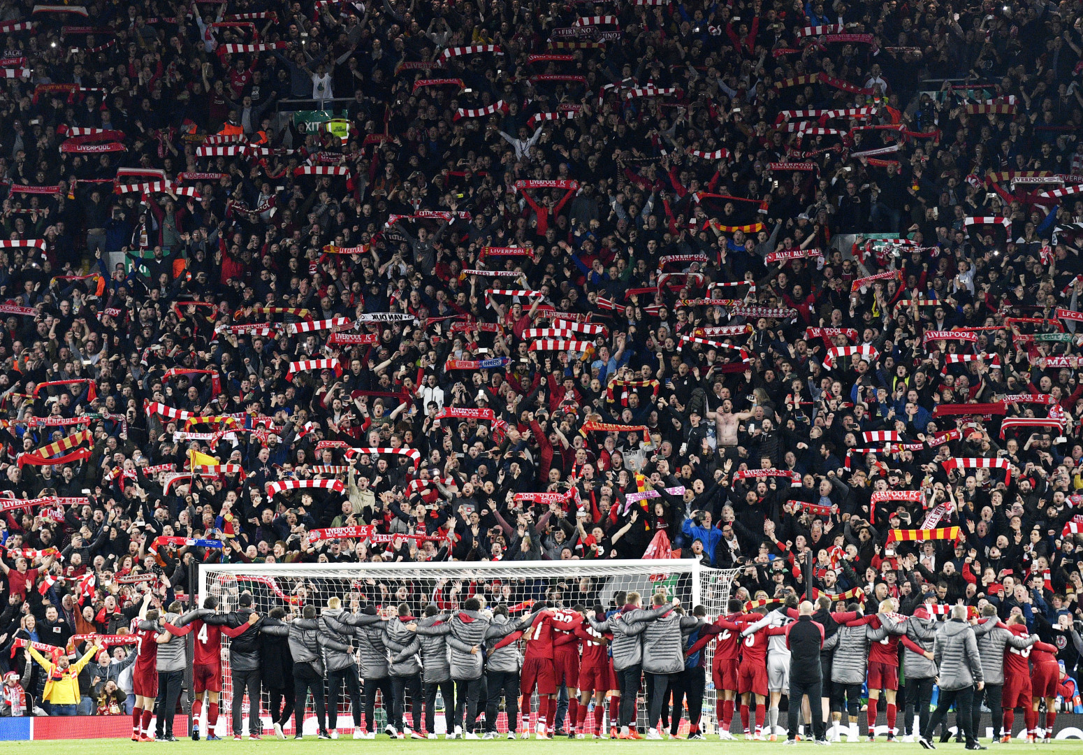 Liverpool players celebrate in front of their fans after the UEFA Champions League semi final 2nd leg match between Liverpool FC and FC Barcelona at Anfield, Liverpool, Britain, 07 May 2019. Liverpool won 4-0 and advanced to the final. (optimized)