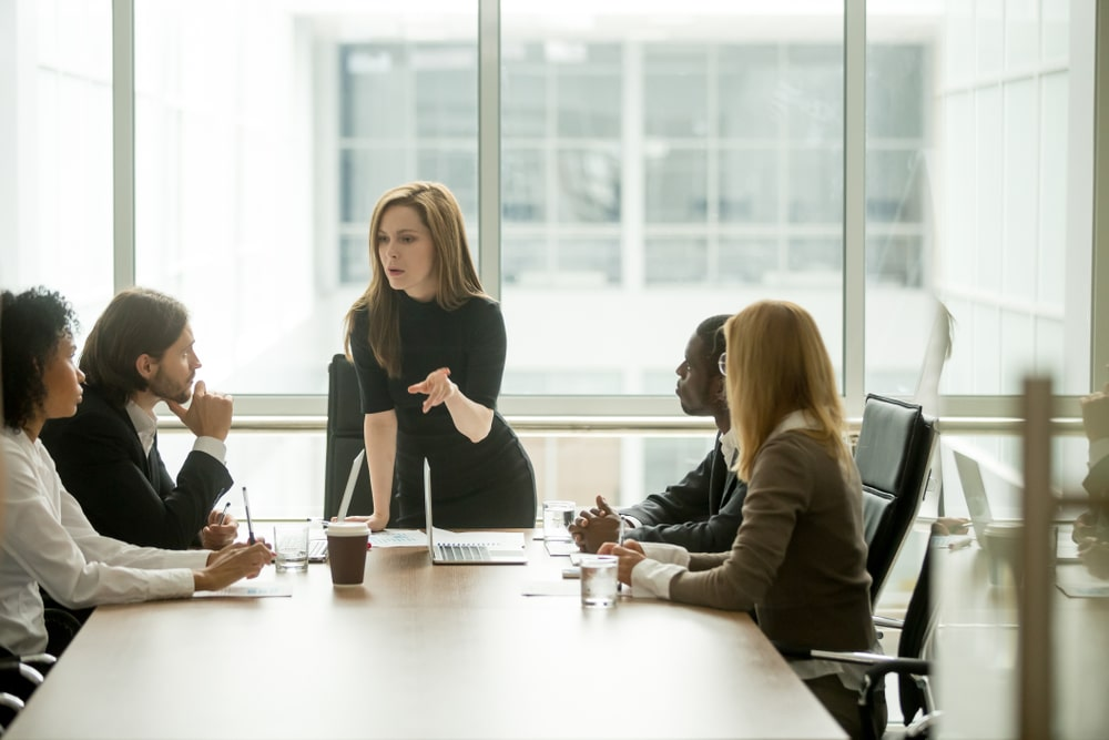 Businesswoman Delegating Work to Team
