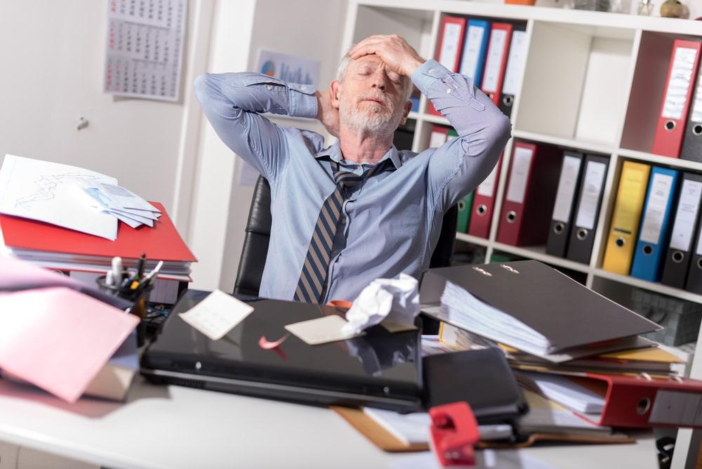 Older White Man Stressed At Work