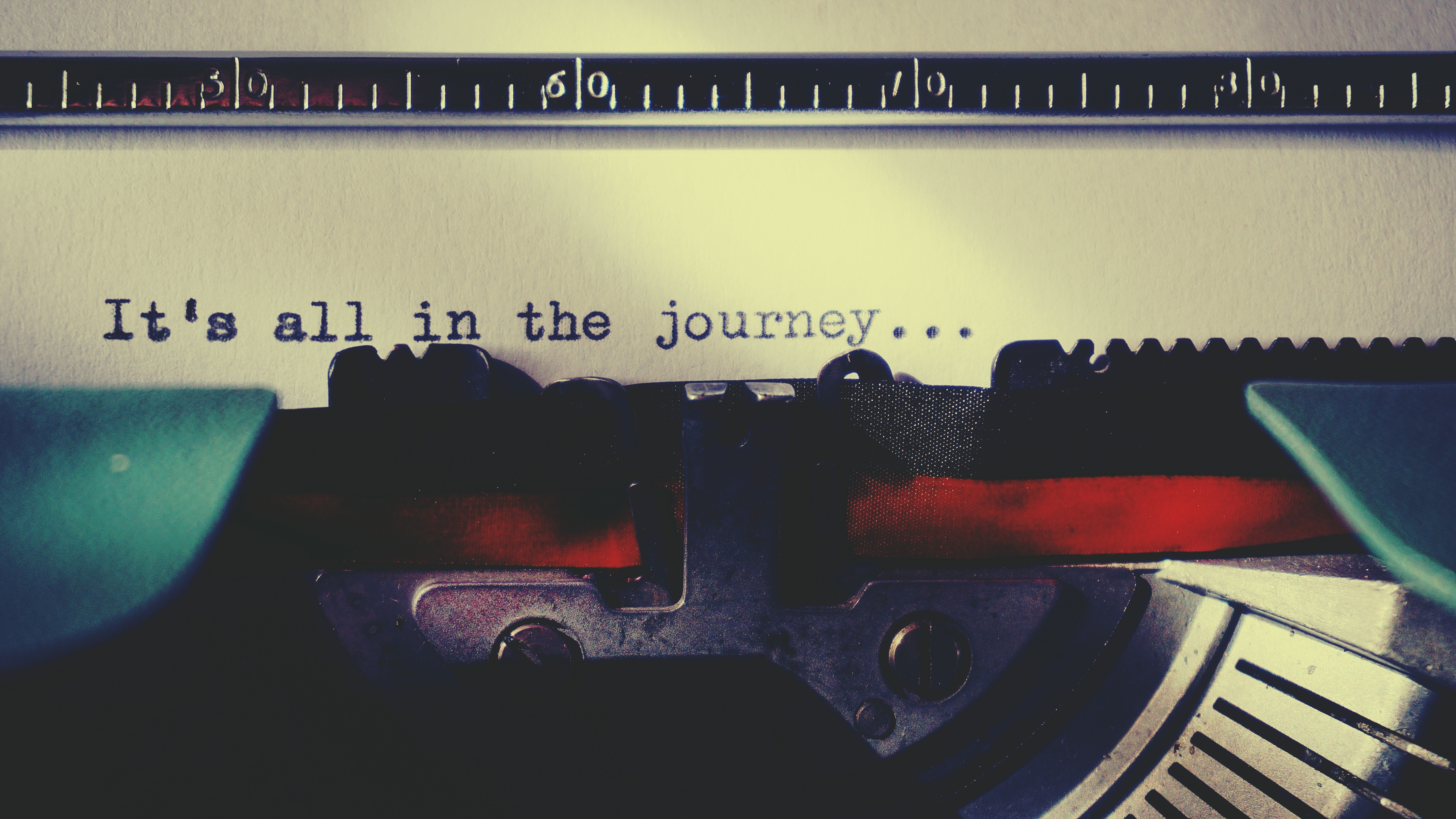 Typewriter with 'It's all in the journey' shown on paper