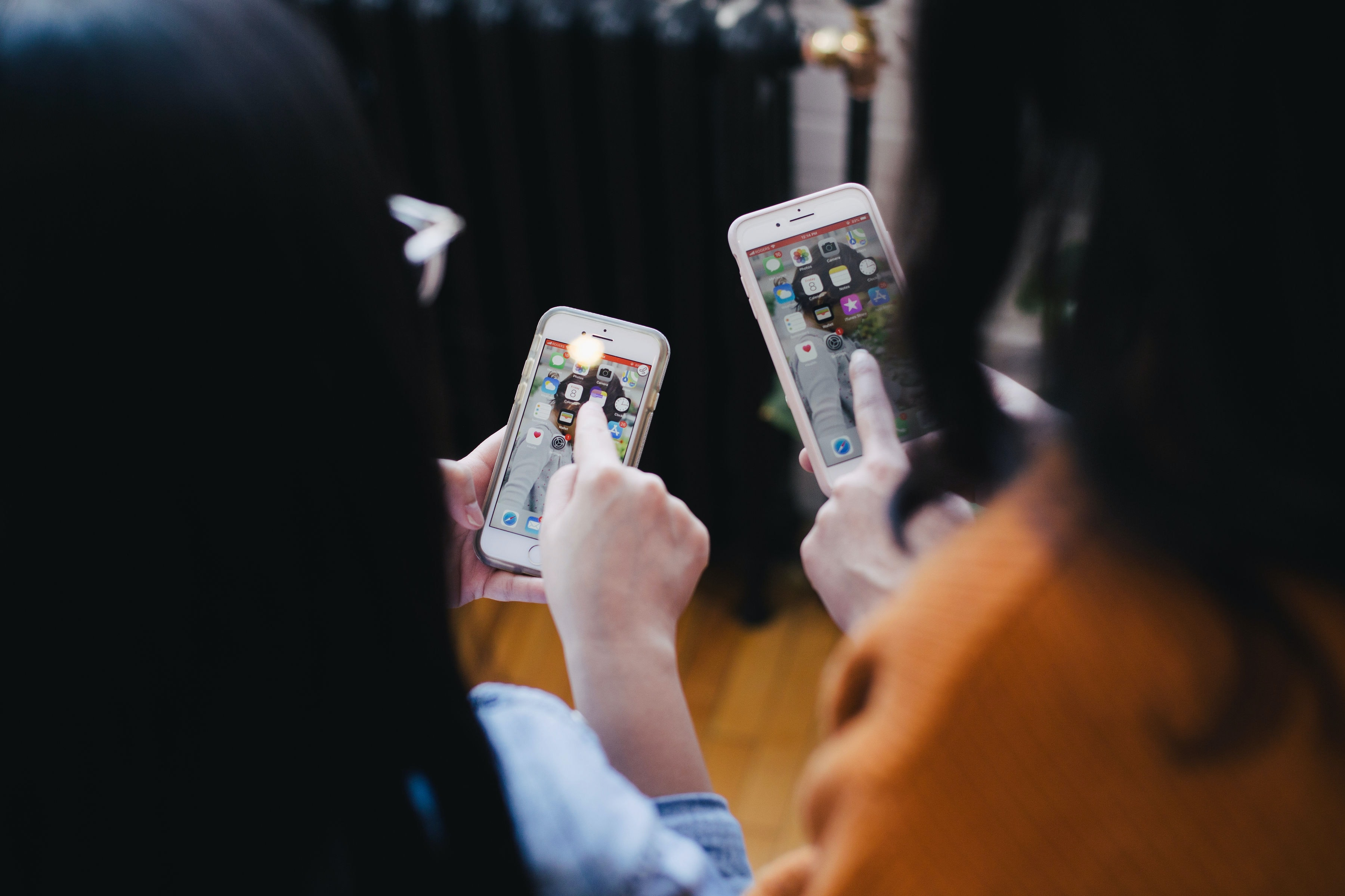 Two women looking at mobile phones