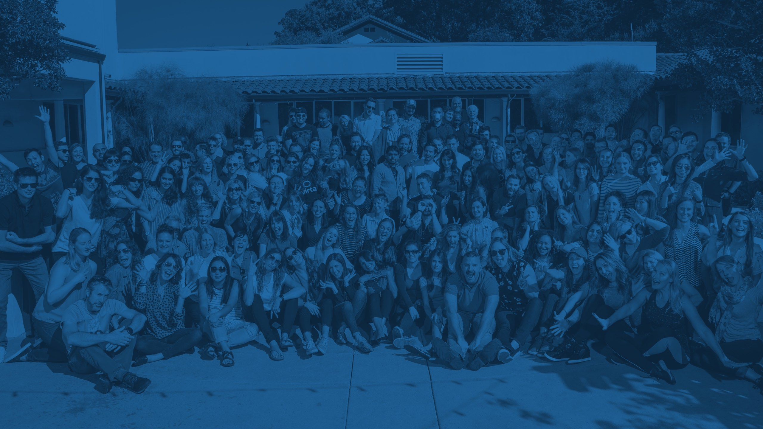 The Virta team standing outdoors, from October 2018 (with a blue overlay)