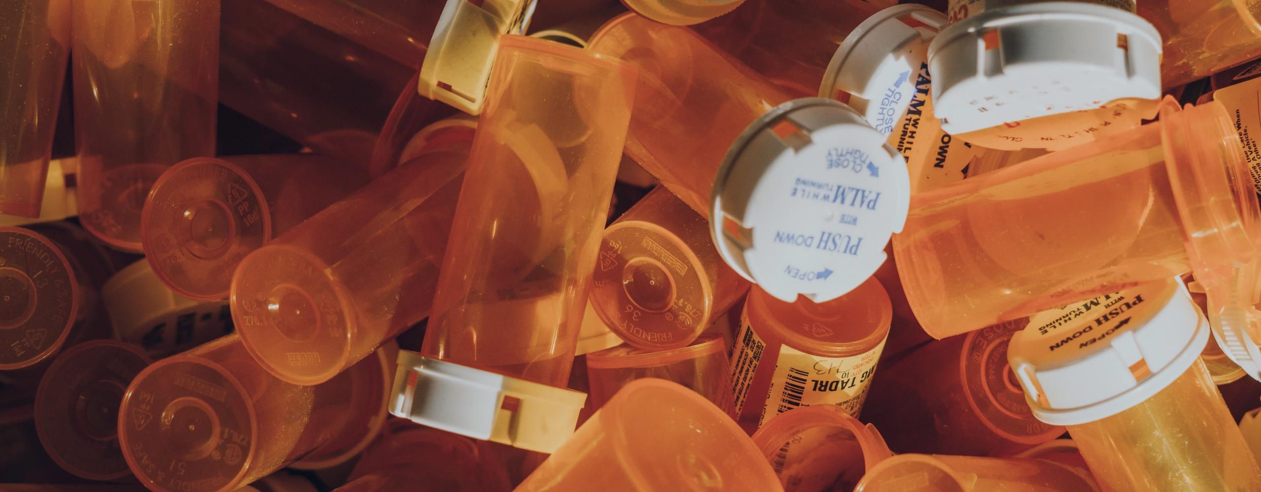 A pile of empty prescription bottles