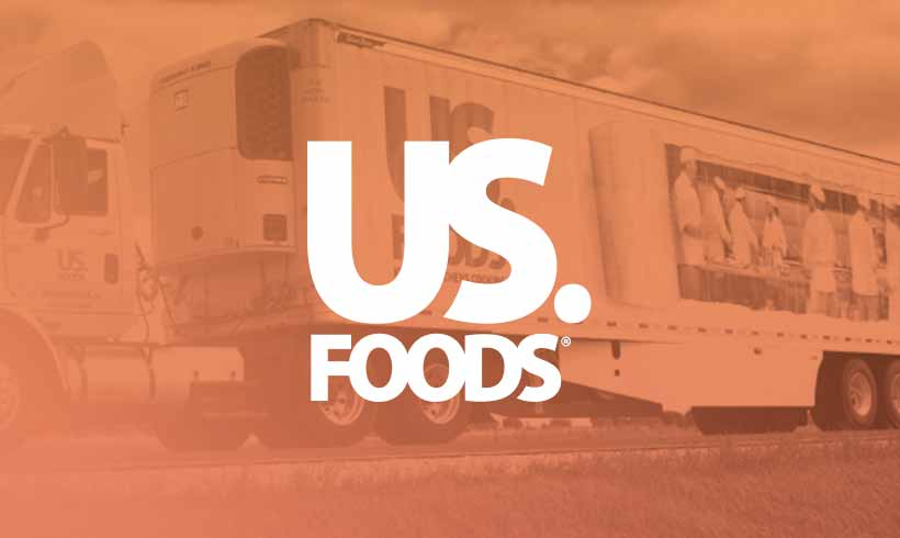 18-wheeler truck in the background with US Foods logo on top