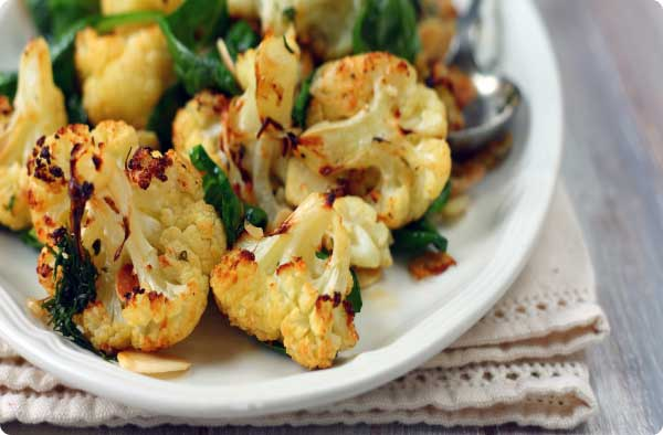 Roasted cauliflower in a white ceramic bowl
