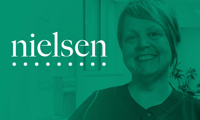 Nielsen logo in the foreground; Virta patient in the background
