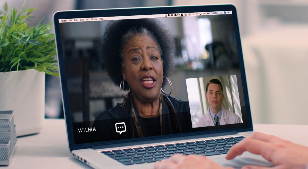 A laptop showing a video call between Wilma (Virta patient) and Dr. Jeff Stanley (Virta clinician)