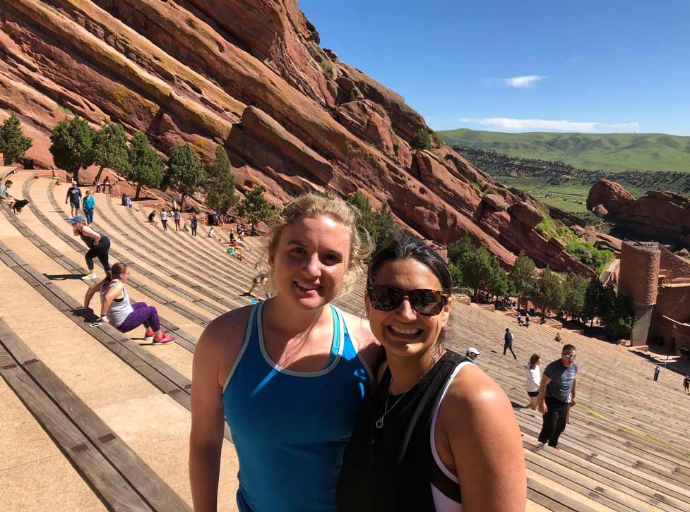 Two Virtans smiling and standing at the Red Rocks Amphitheatre