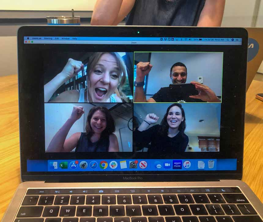 Four Virtans smiling on a Zoom call together