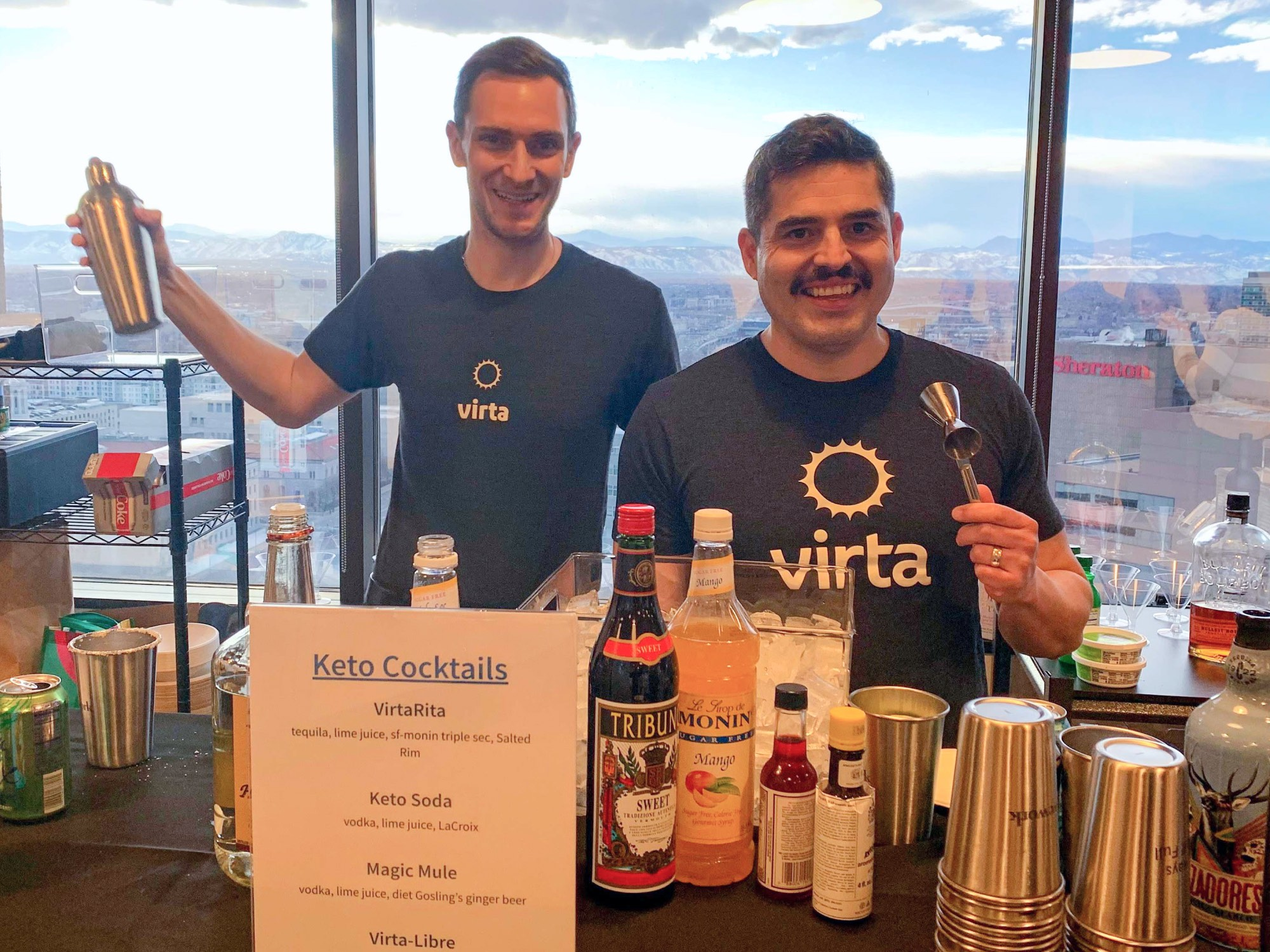 Two Virtans mixing Virta themed cocktails during an office happy hour