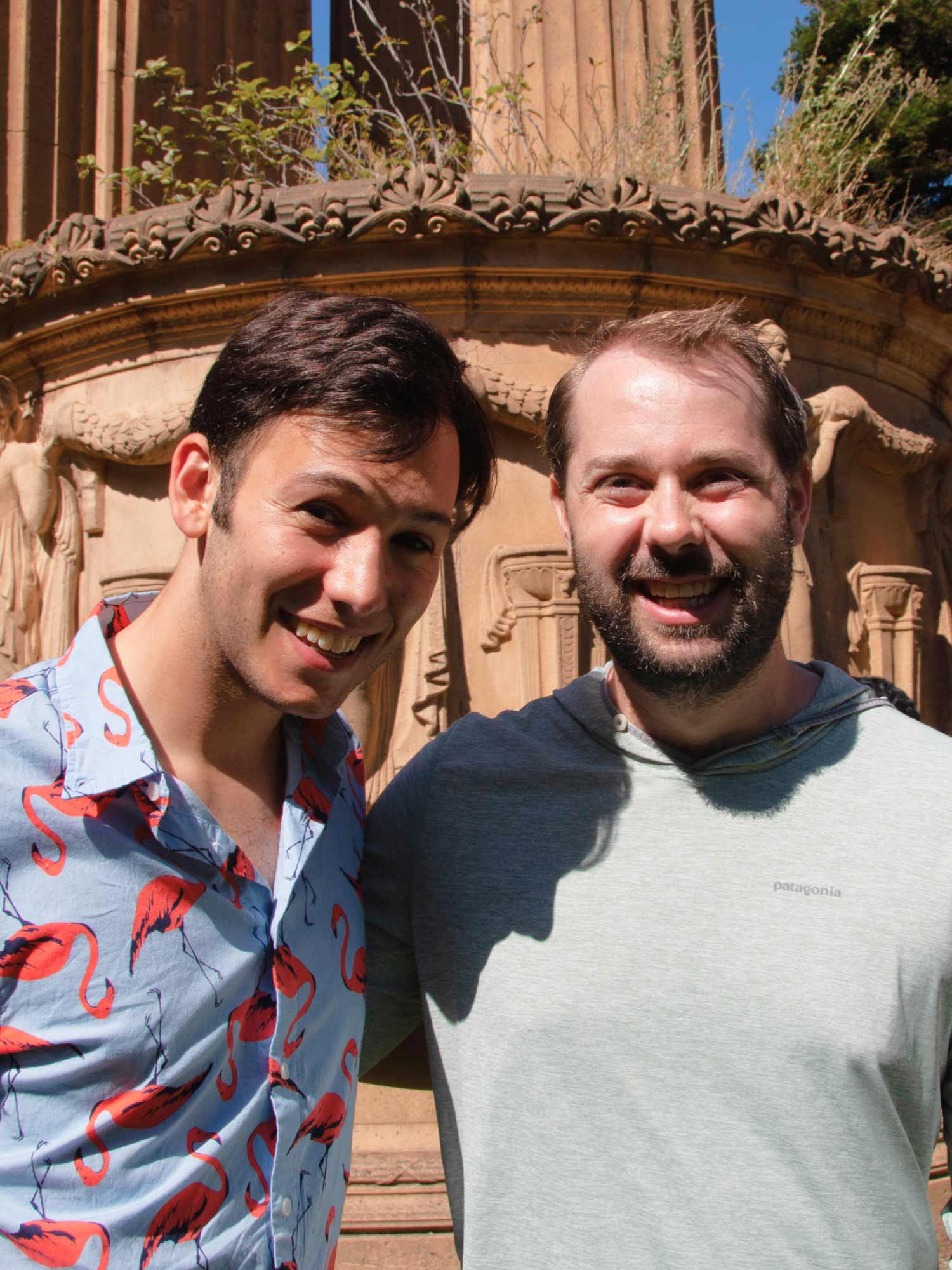 Two Virtans smiling in front of the Palace of Fine Arts in San Francisco