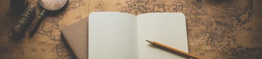 journal and pen on explorer map