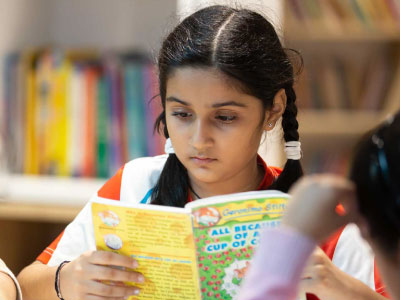 GIIS Singapore  Primary School Girl Studying in School Library