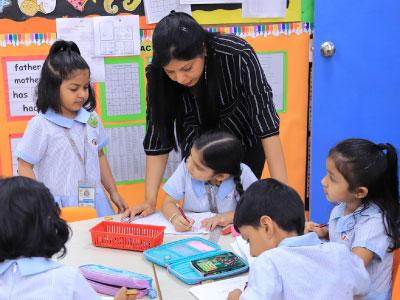 Global Indian International School Singapore Teacher teaching Kindergarten Children