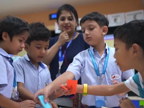 GIIS Primary Teacher Teaching Students through Practical approach