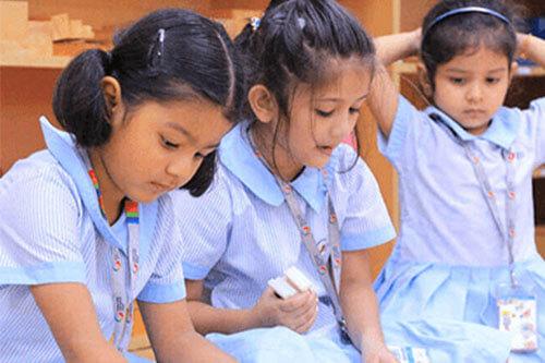 Cute GIIS Kindergarten Girls Studying