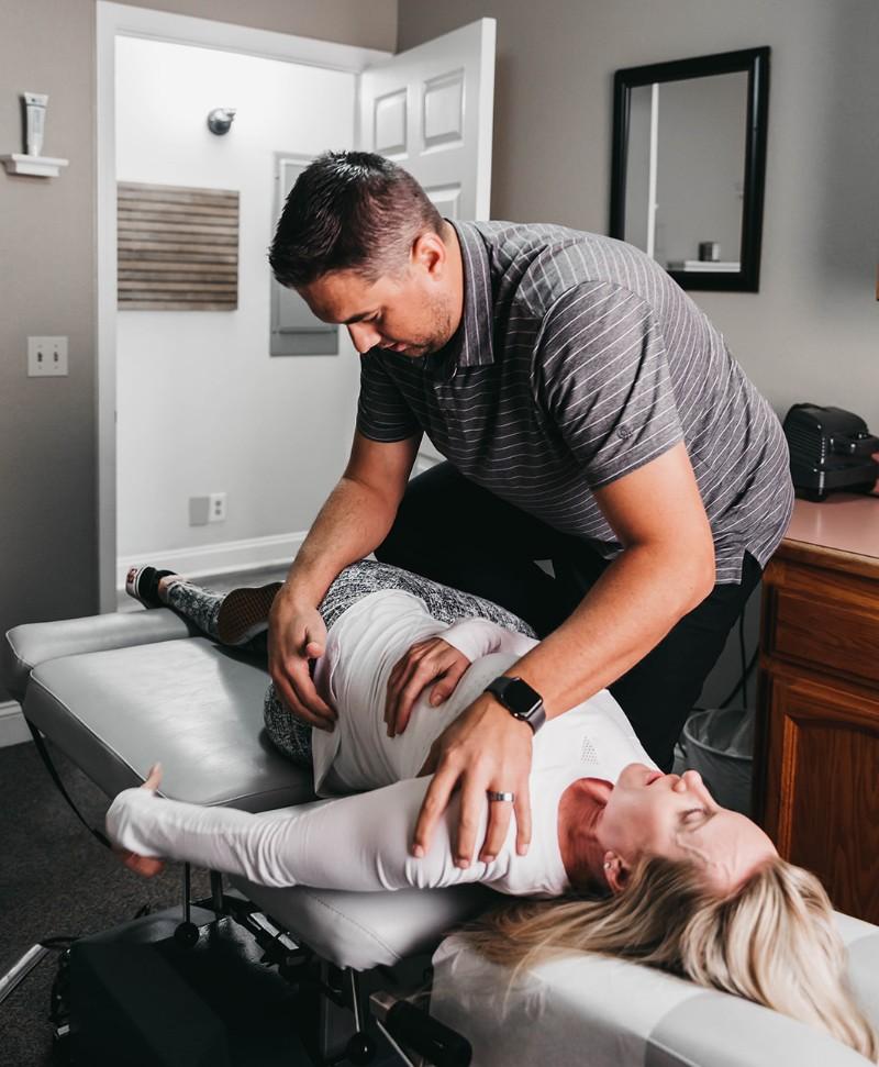 Dr. Beau adjust a patient's back