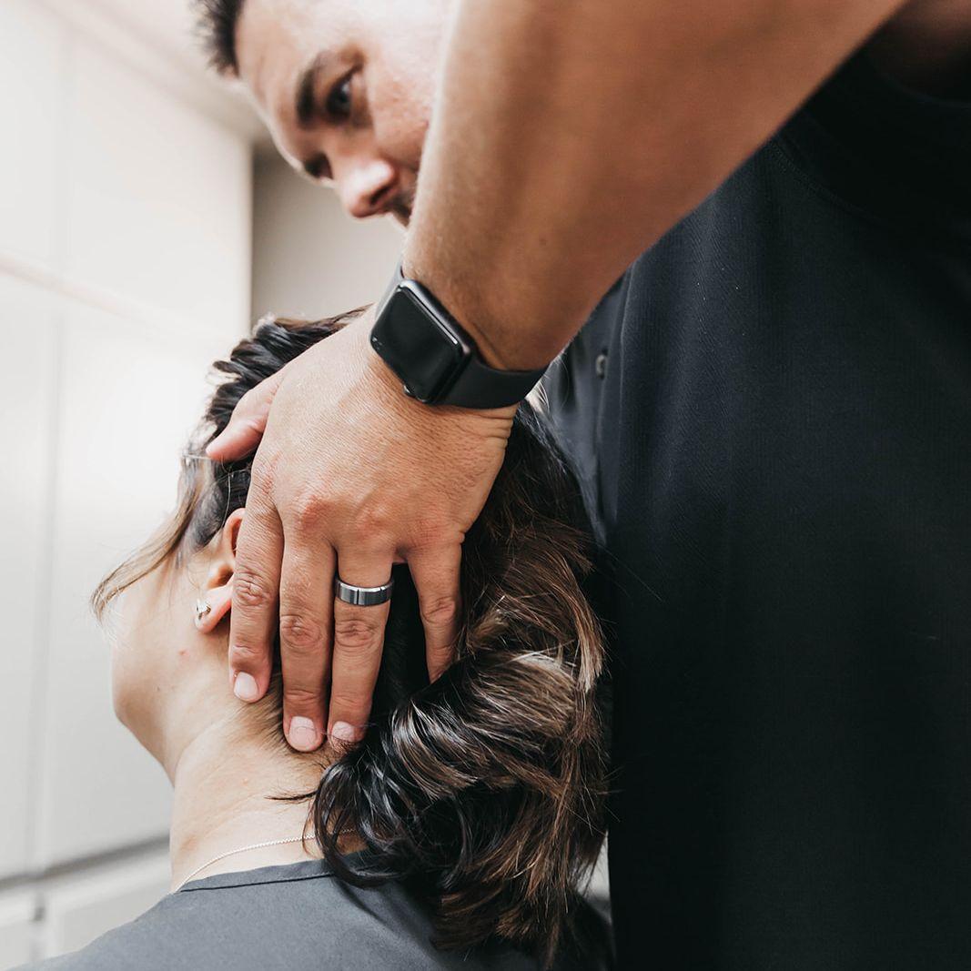 Dr. Beau adjusting a patient's neck