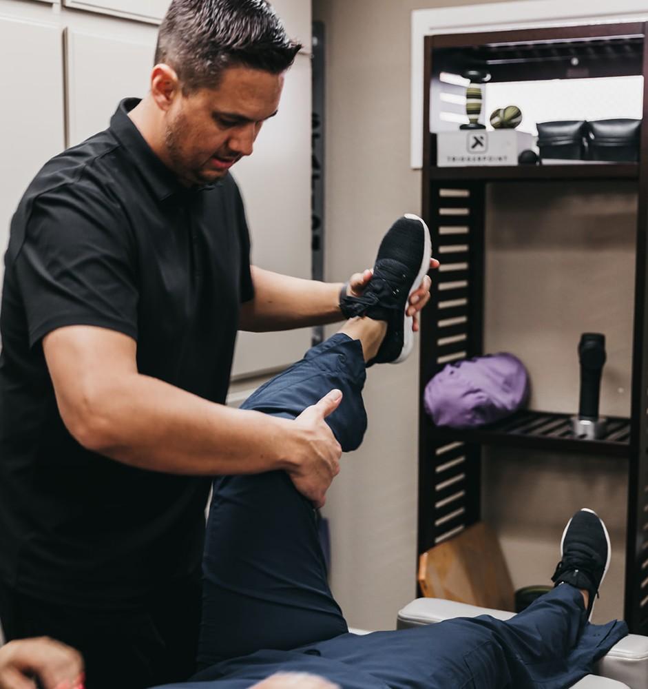 Dr. Beau stretching a patient's hip flexors