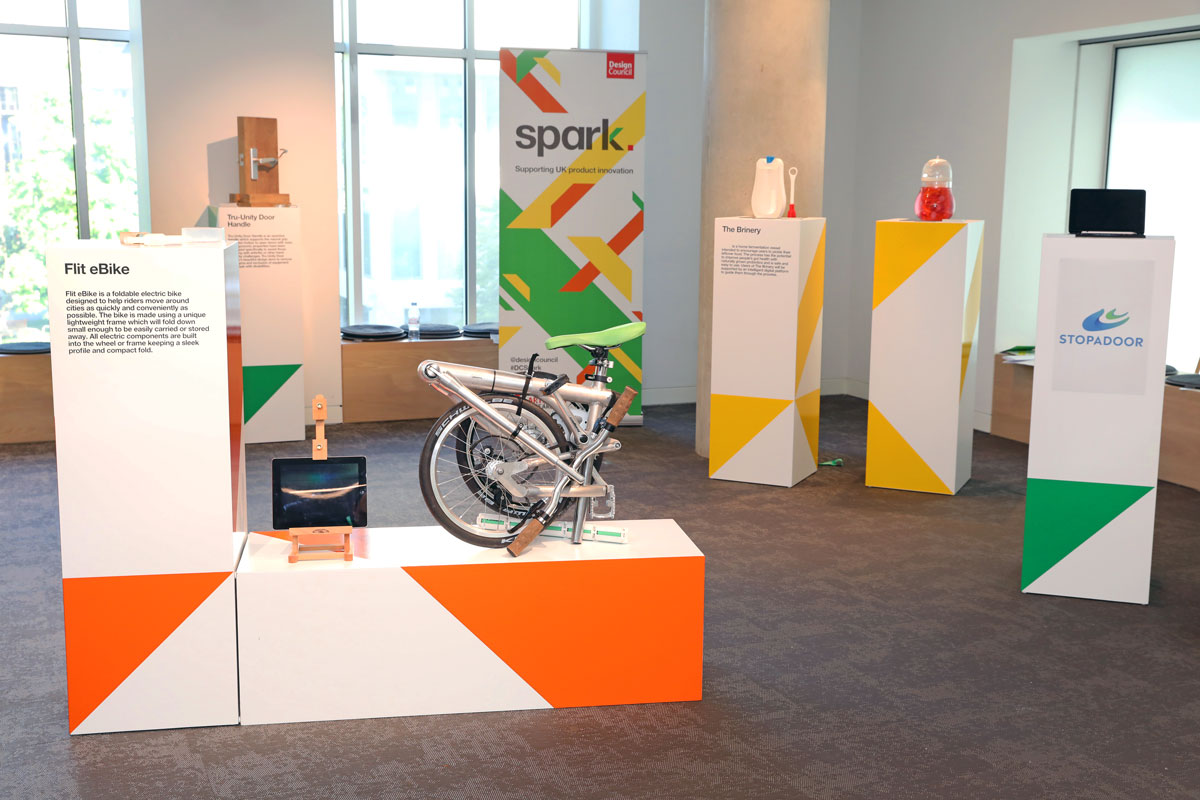 photo of an exhibition with lots of plinths