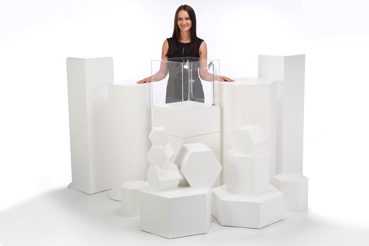 photo of a woman surrounded by plinths ans pedestals