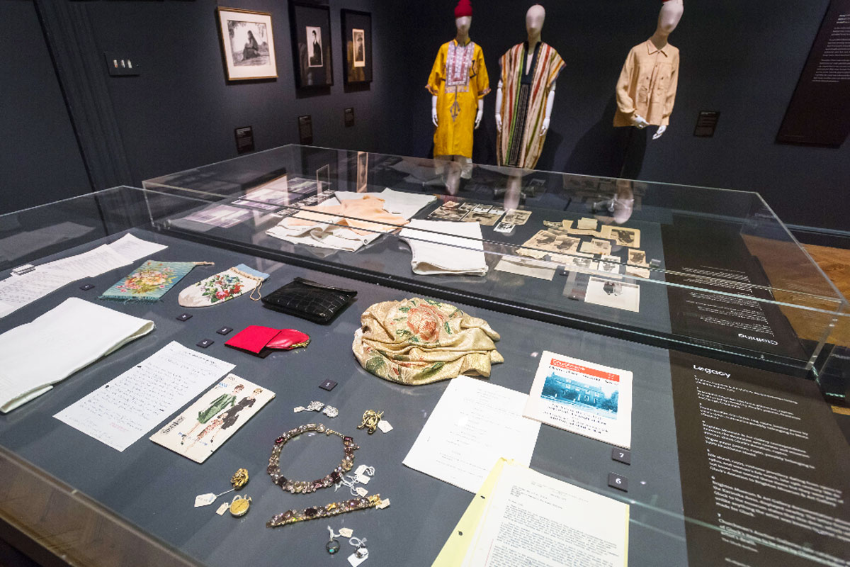 photo of a museum room with items on show behind a plinth display case